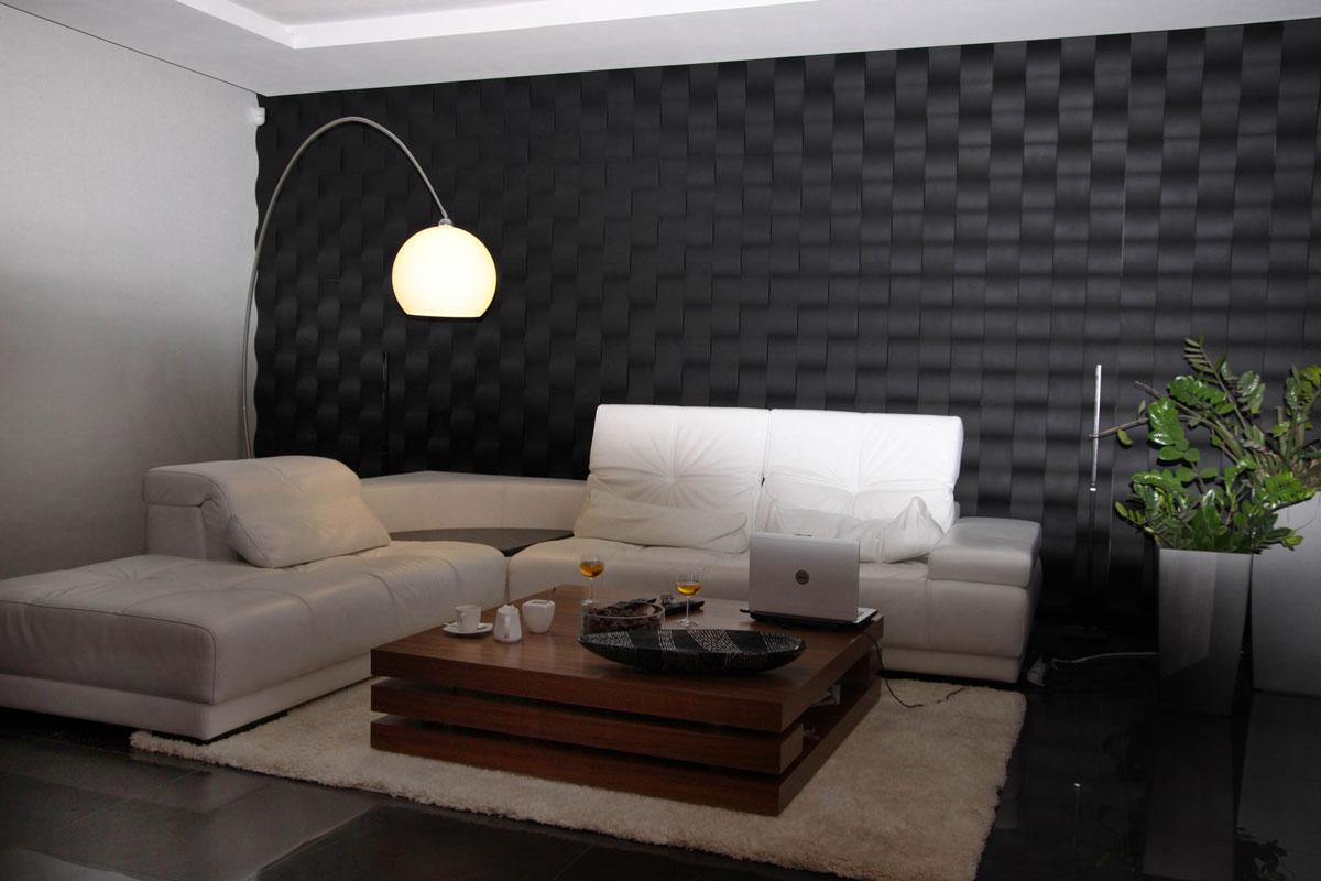 System czarnych paneli ściennych 3D o prostym designie, aranżacja w salonie