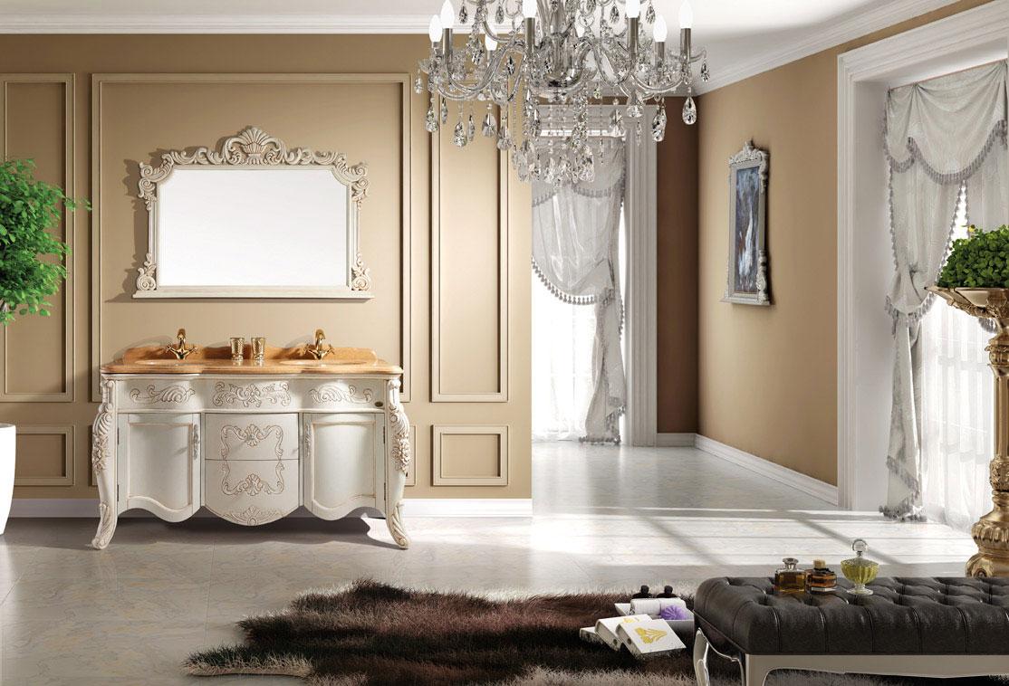Biała, drewniana, stojąca szafka do łazienki. Klasyczna, antyczna, ze złotymi zdobieniami i dużym lustrem.