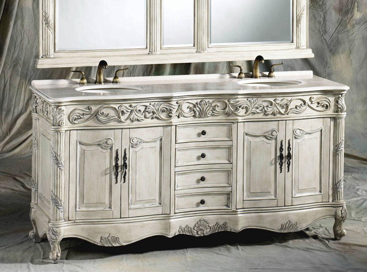 Biała przecierana szafka, komoda do łazienki w stylu prowansalskim. Posiada ręcznie rzeźbione ornamenty, podwójną umywalkę i lustra. Blat wykonany z białego marmuru, ozdobna retro armatura z mosiądzu.