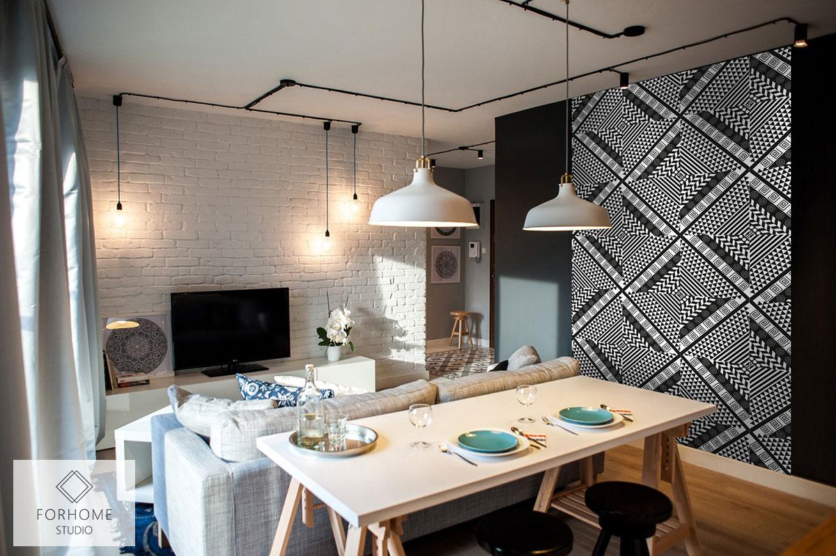 Czarno-biała obiektowa tapeta na ścianie pokoju dziennego